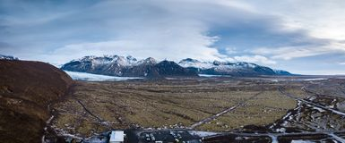 Snowy-Berge in Island-Landschaft Stockbild
