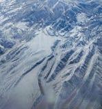 Snowy-Berge von der Luft Stockfoto
