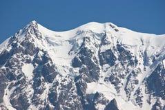Snowy-Bergspitze stockbilder