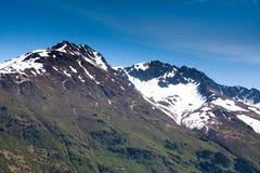 Snowy-Bergspitzen Stockbild