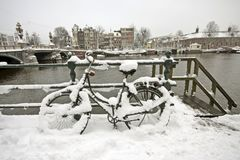 Snowy bicycle in Amsterdam Netherlands Royalty Free Stock Images