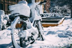Snowed in Bicycle near the Vatican Train Station. A snowy bicycle is trapped under snow that is melting near the Vatican train station Stock Image