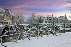 Snowy bicycles in Amsterdam city center the Netherlands Stock Photography