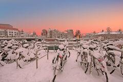 Snowy bicycles in the city center from Amsterdam Netherlands Stock Photography