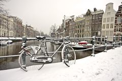 Snowy bike in Amsterdam the Netherlands. Snowy bike in the citycenter from Amsterdam Netherlands in wintertime Royalty Free Stock Images
