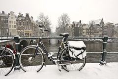 Snowy bike in Amsterdam the Netherlands. Snowy bike in the citycenter from Amsterdam Netherlands in wintertime Royalty Free Stock Photo