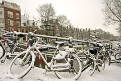 Snowy bikes in Amsterdam the Netherlands Stock Photography