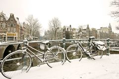 Snowy bikes in Amsterdam the Netherlands Royalty Free Stock Images