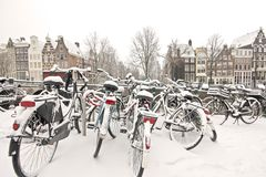 Snowy bikes in Amsterdam the Netherlands. Snowy bikes in the citycenter from Amsterdam Netherlands in wintertime Royalty Free Stock Photos