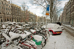 Snowy bikes in Amsterdam the Netherlands Stock Images