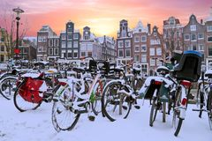 Snowy bikes in Amsterdam the Netherlands. At sunset Royalty Free Stock Photo