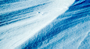 Snowy blue background Stock Image