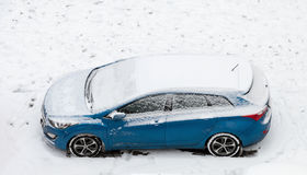 Snowy blue car Royalty Free Stock Photo