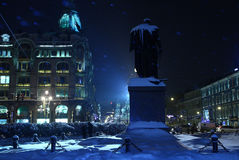 Snowy blue city at night. Winter Saint-Petersburg at night with a monument Royalty Free Stock Image