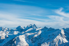 Snowy blue mountains in clouds Royalty Free Stock Photos