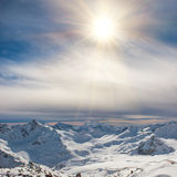 Snowy blue mountains in clouds Royalty Free Stock Photography