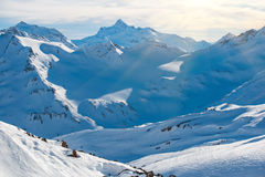 Snowy blue mountains in clouds Stock Image