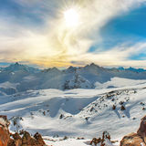 Snowy blue mountains in clouds Royalty Free Stock Image