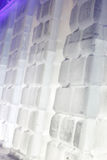 Snowy brick wall with illumination in Ice town Stock Images