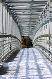 Snowy bridge. Walkway across the expressway made out of metal and wood Royalty Free Stock Photos