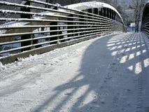 Snowy Bridge. Pedestrian bridge in Winter Stock Photo