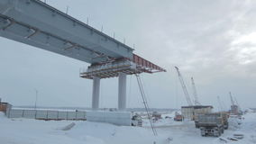 Snowy Bridge Construction Site in Winter stock video footage
