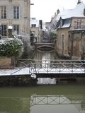 Snowy bridge on the towpath of the Briare canal in Montargis royalty free stock photo