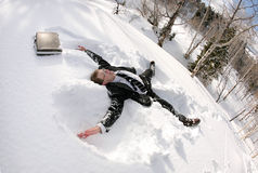 Snowy businessman. Businessman with breifcase making snow angel Royalty Free Stock Photos