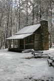 Snowy cabin 2. A snowy, rustic cabin in a rural setting royalty free stock images