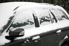 Snowy car. Snowy grey car with mirror, horizontally framed picture stock photography