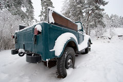 Snowy car. Abandoned snow-covered car in freezing forest area Stock Photo