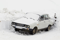 Snowy car Stock Images