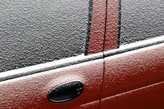 Snowy car door Stock Photo