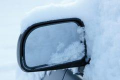 Snowy car mirror Royalty Free Stock Image