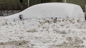 Snowy Car Parked. After the first snow in Bucharest, Liviu Rebreanu Street stock photo