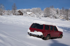 Snowy car parked on a slope Stock Photo
