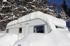Snowy caravan. Lots of snow on swedish caravan, adria Stock Images
