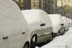Snowy cars. In european city Royalty Free Stock Photo