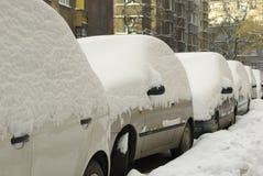 Snowy cars. In european city Royalty Free Stock Photo