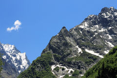 Snowy caucasus mountains and green forest under Stock Image