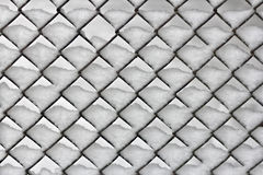 Snowy chain link fence Stock Photography