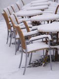 Snowy chairs tables winter Royalty Free Stock Image