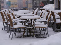 Snowy chairs tables winter Stock Image