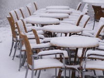 Snowy chairs tables winter Royalty Free Stock Photography