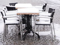 Snowy chairs tables winter Royalty Free Stock Images