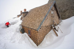 Snowy chalet Stock Image