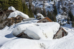 Snowy-Chalet stockbild