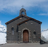 Snowy Chapel. Lone stone chapel in the Swiss Alps Royalty Free Stock Photos