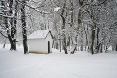 Snowy chapel. Small snowy chapel in the forest Stock Photos
