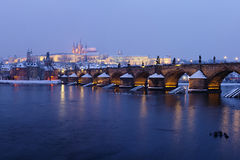 Snowy Charles Bridge at dusk Stock Photo